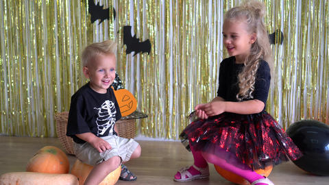 kids cheer each other on Halloween costumes. October dark evil witch fest. 4K GIF