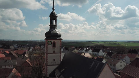 Old german town with a church and a clock tower, historic architecture, 4k Live Action