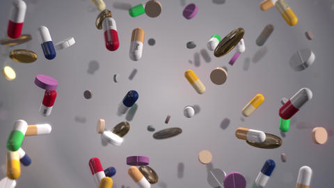 Assorted Colorful Pills Raining on White Live Action