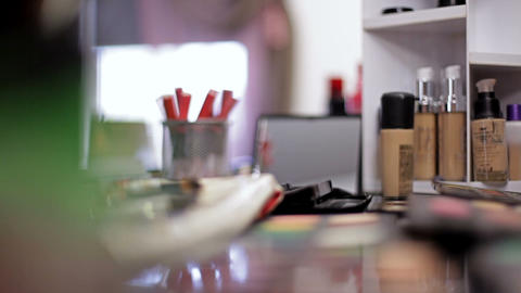 Luxurious cosmetics for make-up. Multicolored lipstick, shadows, powder, pencils Live Action