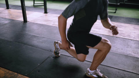 Attractive muscle man exercise and train in gym, muscle gue lunges squat Footage