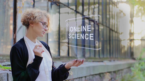 Blonde uses hologram Online science Footage