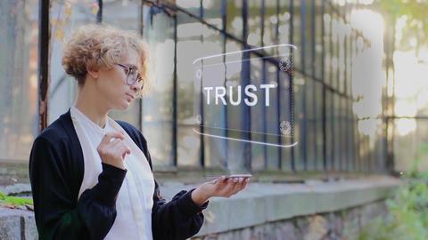 Blonde uses hologram Trust Live Action