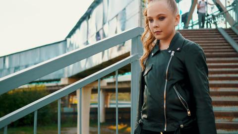 Serious teenage girl in black leather jacket Footage
