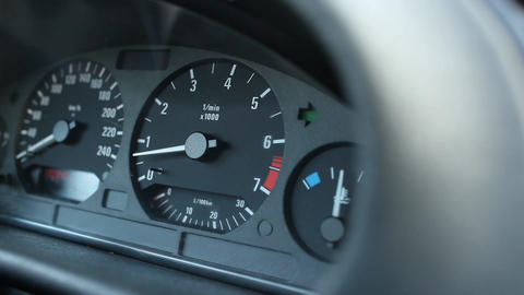 Close up view on car dashboard with blinking green arrow, turn light indicator Footage