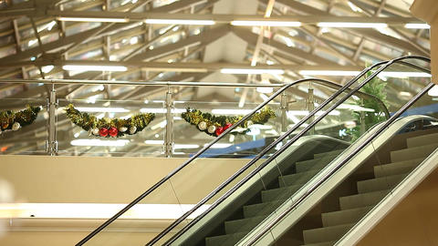 Two empty escalators with glass handrails, automatic staircase to upper floor Footage