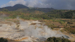 Steaming crater lake Kawah Sikidang in landscape,Dieng,Java,Indonesia Footage