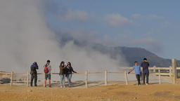 Tourists make selfies at Kawah Sikidang volcanic crater,Dieng,Java,Indonesia Footage