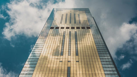 Corporate Buildings, Blue Sky and Clouds Mirrored in Skyscraper. Zoom Out Footage