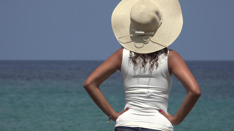 Woman Wearing Hat Staring At Ocean Live Action