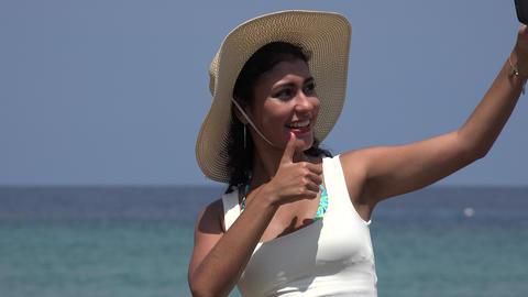 Pretty Woman Taking Selfies At Ocean Footage