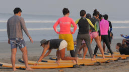 Surf instructor and students on beach,Kuta,Bali,Indonesia Footage