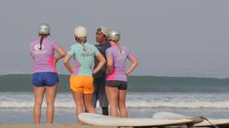 Surf school students and instructor on beach,Kuta,Bali,Indonesia Footage