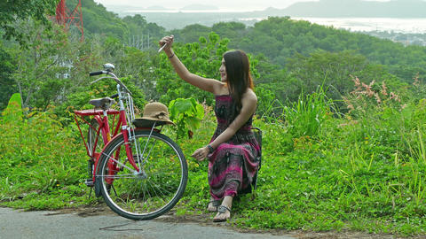 Lady selfie with red bicycle Footage