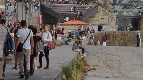 Relaxing at the banks of River Douro in Porto - CITY OF PORTO, PORTUGAL - Footage