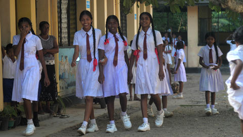 pretty girls in white uniform meet after holidays and walk Archivo