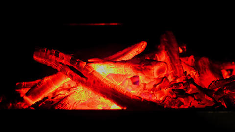 Hot red and orange glow of firewood, charcoal on grill Footage