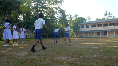 schoolboys prepare to game on playground against school Archivo