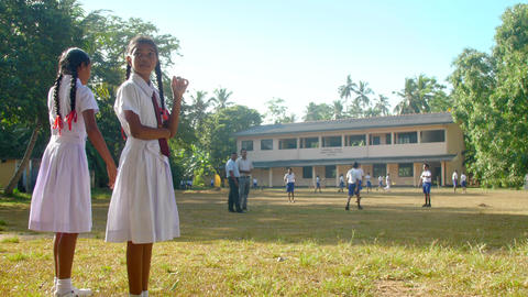 Sinhalese girls in school uniform look at boys Archivo