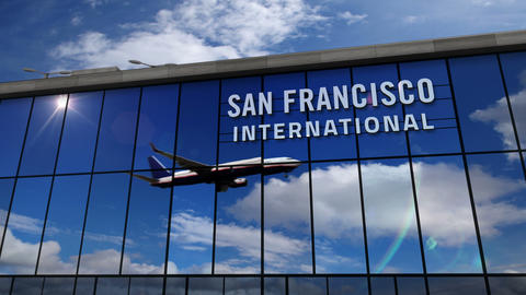 Airplane landing at San Francisco California mirrored in terminal Live Action