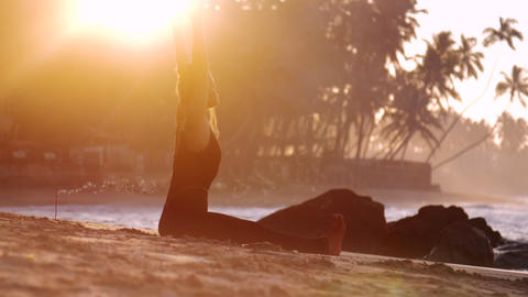 barefoot lady meditates in yoga asana on sand beach Footage