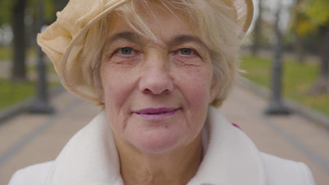 Extreme close-up of senior Caucasian woman with blue eyes looking at the camera Live Action
