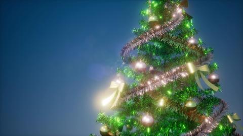 Joyful studio shot of a Christmas tree with colorful lights Footage