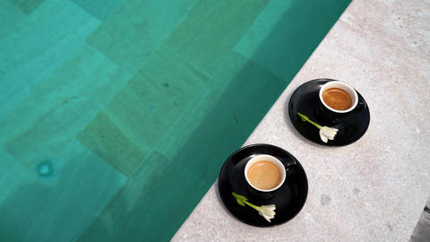 Coffee in espresso cups for two people on luxury pool side on vacation Live Action