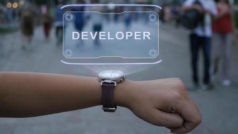 Female hand with hologram Developer Live Action
