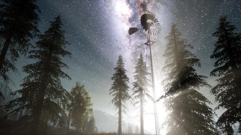 retro windmill in mountain forest with stars. hyperlapse Footage