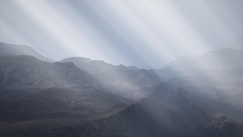 Sun Rays against the Backdrop of the Mountains Footage