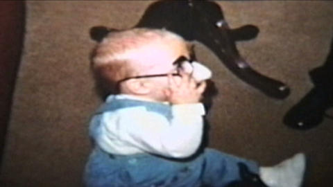 Baby Wearing Funny Glasses 1964 Vintage 8mm film Stock Video Footage