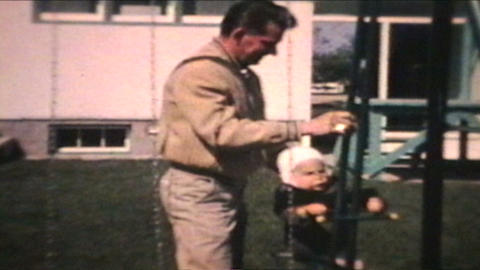 Dad Pushes Little Boy On Swing 1963 Vintage 8mm film Stock Video Footage