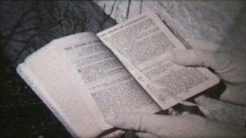 Girl Holding Bible 1960 Vintage 8mm film Stock Video Footage