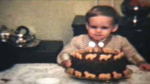 Little Boy Blows Out Candles On Cake 1964 Vintage 8mm Film stock footage