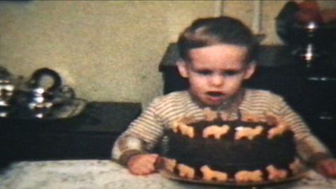 Little Boy Blows Out Candles On Cake 1964 Vintage 8mm film Stock Video Footage