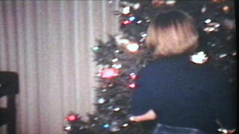 Putting Presents Under Christmas Tree 1978 Vintage 8mm film Stock Video Footage