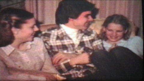 Teenagers Enjoy Christmas Tree 1980 Vintage 8mm film Stock Video Footage