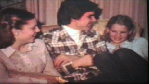 Teenagers Enjoy Christmas Tree 1980 Vintage 8mm film Stock Video Footage