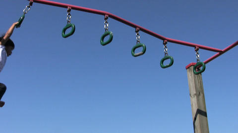Little Girl On Playground Rings Stock Video Footage