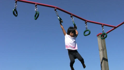 Little Girl On Playground Rings Footage