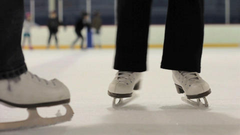 Mother And Daughter Practice Ice Skating Together Footage