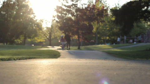 Proud Dad Helps Daughter Ride Bike Down Hill Stock Video Footage