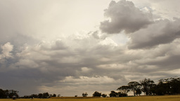 Time Lapse of Storm Clouds Brewing over a Farm Stock Video Footage