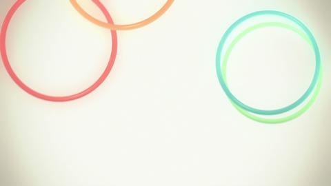 Falling, Bouncing Colorful Rings in Slow Motion Loop Stock Video Footage