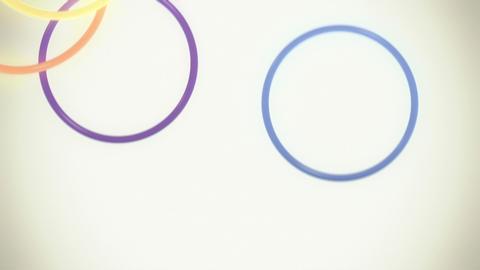 Falling, Bouncing Colorful Rings in Slow Motion Loop Stock Video Footage