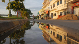 Reflection of houses and motorcycle in pool after rain,Kampong Cham,Cambodia Footage