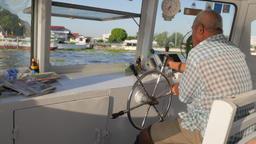 Ferry driver across Chao Praya river,Bangkok,Thailand Footage