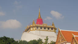 The golden mount hilltop temple at Wat Saket,Bangkok,Thailand Footage