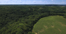 High Angle Aerial Over Woods and Farmlands of Pennsylvania Footage
